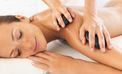 image for Reflexology or Hot Stone, Warm Bamboo, Aromatherapy or Swedish Massage at Hamer Holistics (Up to 58% Off)
