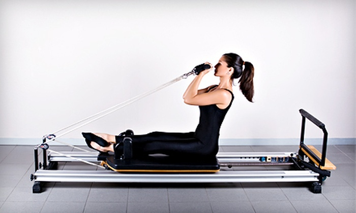 Body in Balance Yoga and Pilates - Mineola: 5 or 10 Group Fitness Classes or 3 Pilates Reformer Classes at Body in Balance Yoga and Pilates (Up to 67% Off)