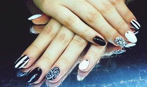 Finest Nails: Gel Manicure, Basic Mani-Pedi, or Regular or Dipping Powder Acrylic Nail Set at Finest Nails (Up to 43% Off)
