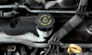 AAMCO: AC Service and Oil Change or Front or Rear Brake Service at AAMCO (Up to 64% Off)
