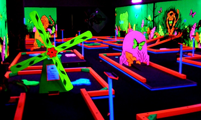 Glowgolf - Multiple Locations: Unlimited Rounds of Glow-in-the-Dark Mini Golf During One Visit for Two or Five at Glowgolf (Up to 57% Off)