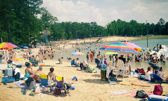 Tucker Lake - Banner: Beach-Fun-Park Visit for Two or Four, or a Summer Family Pass at Tucker Lake (Up to 72% Off)
