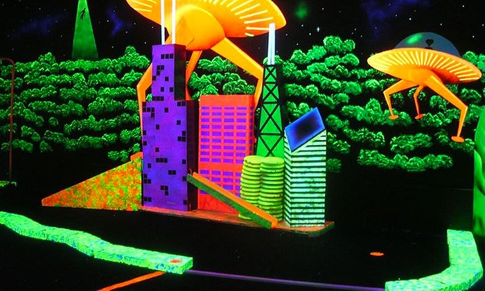 Space Golf - Orland Park: 18 Holes of Black-Light Mini Golf with 3-D Glasses for Two or Four at Space Golf (Up to 48% Off)