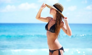 Knead the Knots: One, Three or Five Airbrush Tans at Knead the Knots (Up to 54% Off)