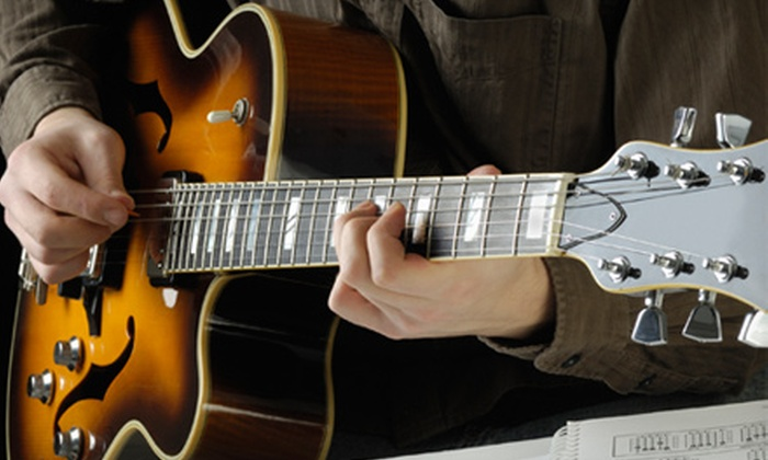 Yellow Frog Guitar Classes - The Waterfront: Four or Eight 90-Minute Guitar Classes with Music Book at Yellow Frog Guitar Classes (55% Off)