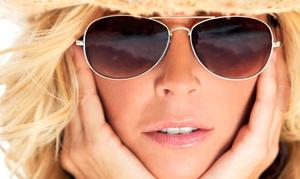 Invidia Hair Design: One or Three Custom Airbrush Tans at Invidia Hair Design (Up to 54% Off)
