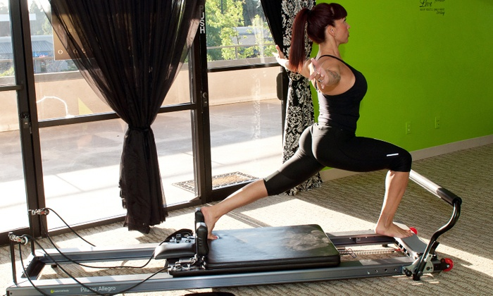 Brand E Pilates - Bullard: 6 or 12 Group Pilates Reformer Classes or 5 Personal Training Sessions at Brand E Pilates (Up to 53% Off)