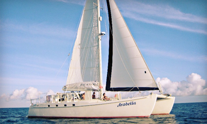 Fun Cat Sailing - Pons Grant: Three-Hour Sunset Catamaran Cruise for 2, 4, or 6 or a Private Cruise for Up to 30 from Fun Cat Sailing (Up to 52% Off)