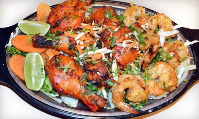 Taj Indian Cuisine - Fredericksburg: Indian Cuisine for Dinner for Two or Four at Taj Indian Cuisine (Up to 52% Off)