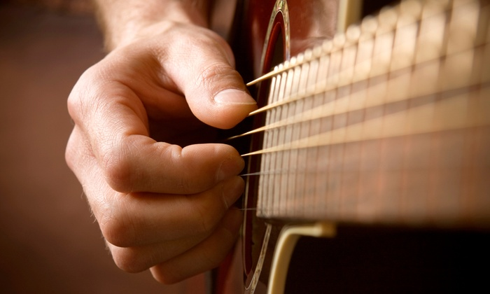 American Guitar Academy - Elmhurst: $49 for Four Private Guitar Lessons with Free Lesson e-Book at American Guitar Academy ($129.95 Value)