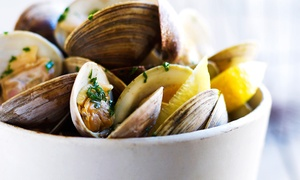 The Tributary: Seafood and Steak Dinner for Two or Four at The Tributary Restaurant in Winsted (Up to 45% Off)