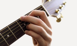 American Guitar Academy: $49 for Four Private Guitar Lessons with Free Lesson e-Book at American Guitar Academy ($129.95 Value)