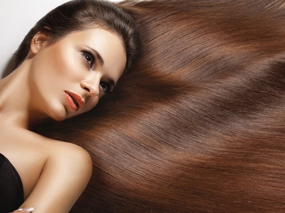 Haircut with a Shampoo, Base Color, or Partial Highlights at Peachtree Tan and Salon (48% Off)
