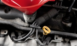 Dupont Tire & Auto Inc.: Oil Change with Optional Rotation and Inspection or Full Brake Service at Dupont Tire & Auto Inc. (Up to 60% Off)
