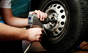 Ultra Tune Automotive Service: Oil Change Package or Wheel Alignment at Ultra Tune Automotive Service (Up to 54% Off)