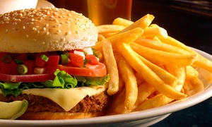 Nelly Spillane's: Pub Meal with Beer for Two or Four or Wings and Beer for Four or Ten at Nelly Spillane's (Up to 57% Off)