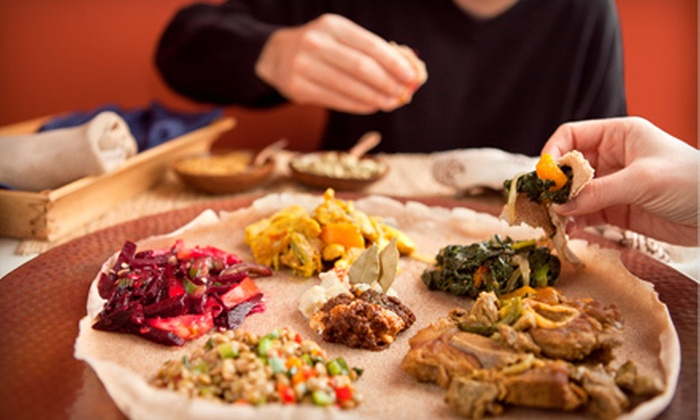 Blue Nile Ethiopian Cuisine - Central City: Ethiopian Fare and Nonalcoholic Drinks for Two or Four at Blue Nile Ethiopian Cuisine (Half Off)