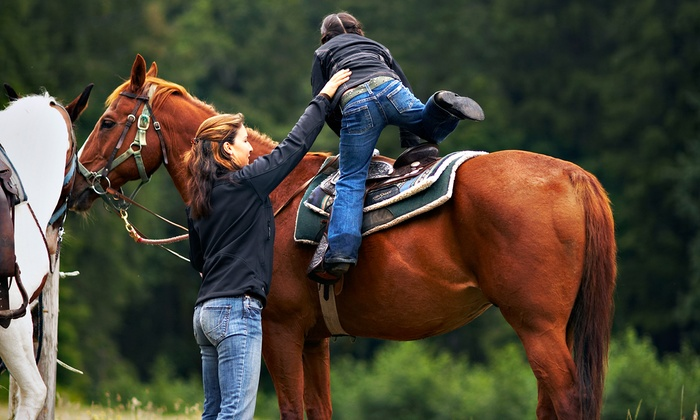Equestrian Quest Stables - Geneva Whitcombs: One-Hour Horseback Trail Ride for Two or Four at Equestrian Quest Stables (Up to 50% Off)