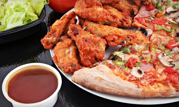 Hungry Howie's - Coral Ridge Country Club Estates: $15 for a Large Three-Topping Pizza with Wings, Salad & Cinnamon Bread at Hungry Howie's in Fort Lauderdale ($32 Value)