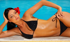 Sizzle Tans: Seven Days of VIP Tanning, Two VersaSpa Spray Tans, or One Custom Airbrush Tan at Sizzle Tans (Up to 83% Off)