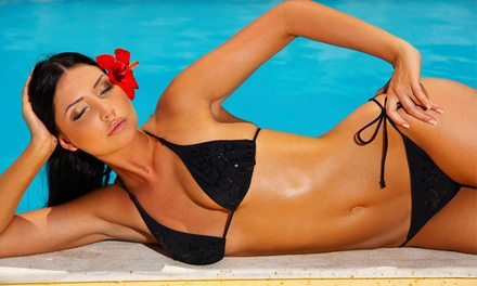 Seven Days of VIP Tanning, Two VersaSpa Spray Tans, or One Custom Airbrush Tan at Sizzle Tans (Up to 83% Off)