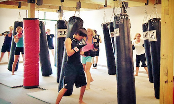 MOAB Fighting Concepts - Newnan: 5 or 10 Cardio-Kickboxing Classes or One Month of Unlimited MMA Classes at MOAB Fighting Concepts (Up to 70% Off)