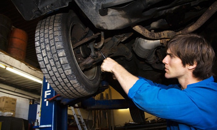 Dulles Automotive Service Center - North Dulles Buisness Center Condominiums: Front, Rear, or All-Wheel Replacement of Brake Pads or Shoes at Dulles Automotive Service Center in Sterling (Up to 66% Off)