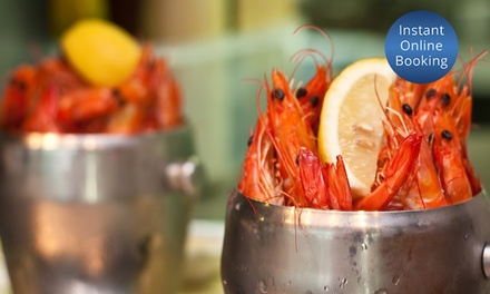 Buckets of Prawns + Bottle of Wine: 2 $37.50, 4 $74 or 6 People $106.50 at Blue Fish Restaurant Up to $264 Value