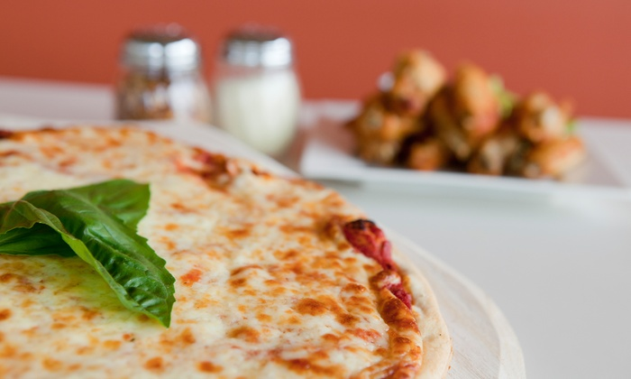 PJ's Paesan's Pizza - Huntington: Pizzas, Breadsticks, and Soft Drinks at PJ's Paesan's Pizza (Up to 49% Off). Three Options Available.
