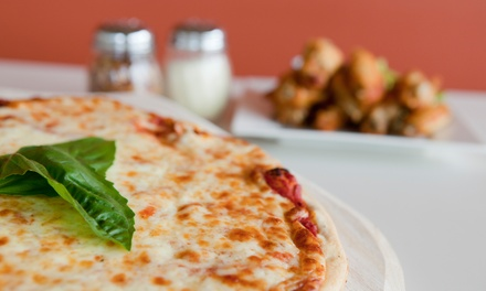 Pizzas, Breadsticks, and Soft Drinks at PJ's Paesan's Pizza (Up to 49% Off). Three Options Available.