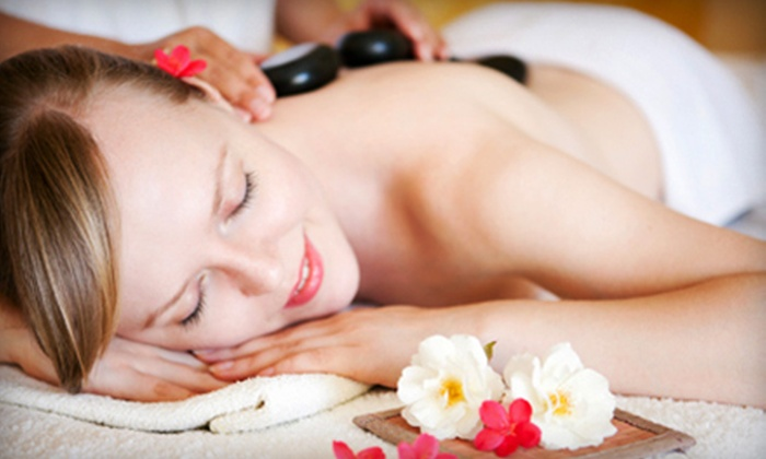 Heaven Salon & Spa - Williamsville: Therapeutic or Hot-Stone Massage, or European Facial and Paraffin Hand Treatment at Heaven Salon & Spa (Up to 52% Off)