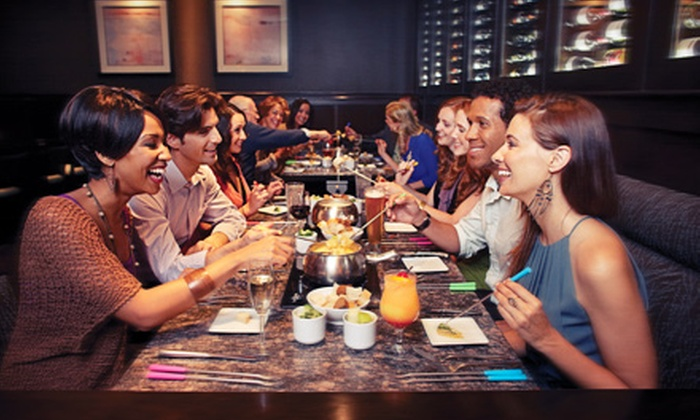 The Melting Pot - Lower Garden District: Steak and Lobster Three-Course Fondue Dinner with Wine for Two at The Melting Pot ($99 Value)