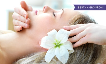 $149 for a Spa Package with Massage, Mani-Pedi, Facial, and Complimentary Wine at Spa Logic ($295 Value)