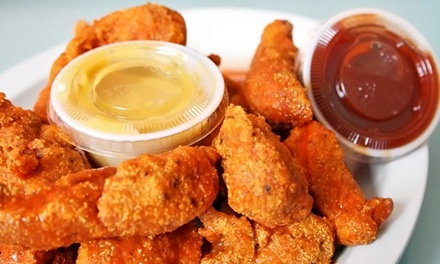 $15 for $25 Worth of Wings and More or 50-Wing Bucket with Soda at Atomic Wings (40% Off)
