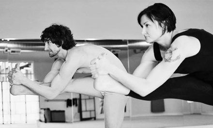 10 or 20 Drop-In Bikram Classes at SweatBox Yoga (Up to 84% Off)