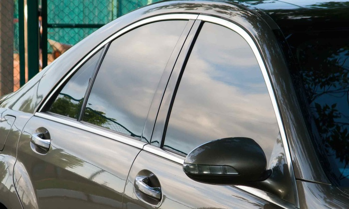 The Tint Guy, LLC - Saint Charles: $149 for a CarbonXP 35% Window-Tinting Package with Sun Strip at The Tint Guy (Up to $300 Value)