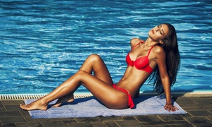 SKYNN: One or Four Custom Airbrush Tans at SKYNN (Up to 48% Off)