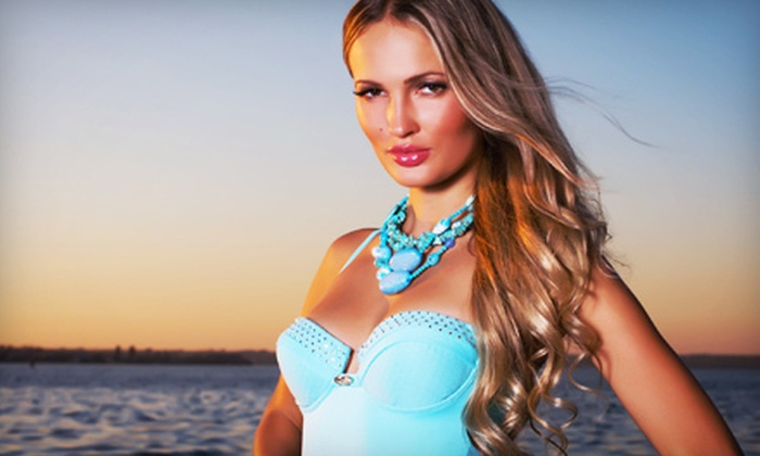 Tan FX - Steinhauer: 200 Minutes of UV Tanning or Two Mystic Spray Tans at Tan FX (Half Off)