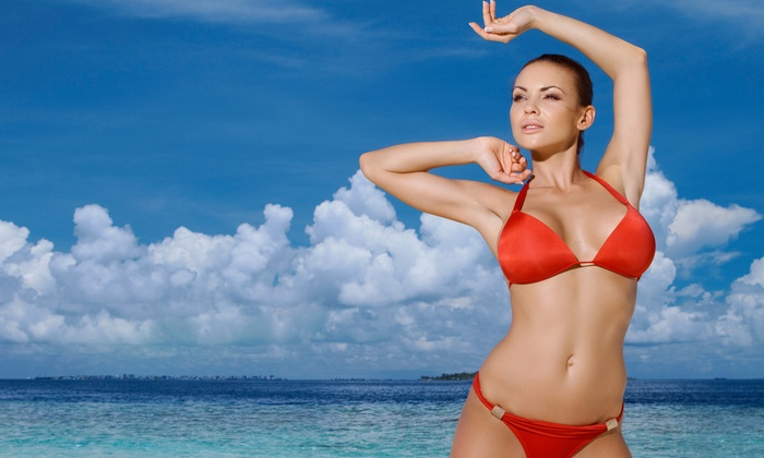 Planet Tan - Clearwater: One or Three Personalized Airbrush Tans at Planet Tan in Clearwater (Up to 61% Off)