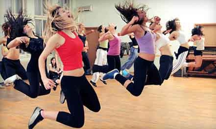 Steve Nash Fitness World - Multiple Locations: $29 for a Month of Group Fitness Classes & Gym Access with Shirt at Steve Nash Fitness World & Sports Club ($105 Value)