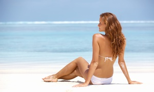 Sun Touch Tanning: One Airbrush Tan or One Month of Basic or Deluxe UV Tanning at Sun Touch Tanning (Up to 50% Off)