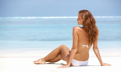 One Airbrush Tan or One Month of Basic or Deluxe UV Tanning at Sun Touch Tanning...