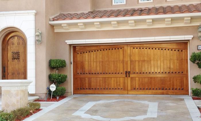 Sam's Garage Doors - Stanton: Garage-Door Tune-Up Packages with New Door Opener or Nylon Rollers from Sam's Garage Doors (Up to 69% Off)