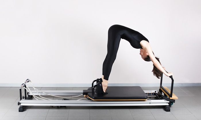 Escape Pilates Studio - Multiple Locations: $49 for Five Group Reformer Classes at Escape Pilates Studio ($140 Value)