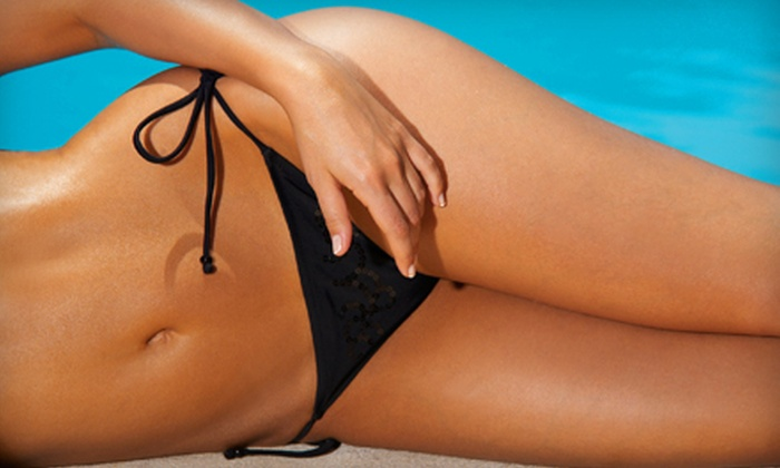 Sunbright Tanning Salon - Bloom Crossing: One or Three Mystic Spray Tans or One Month of UV Tanning at Sunbright Tanning Salon in Manassas Park (Up to 62% Off)