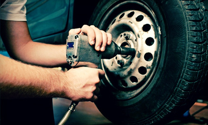 Caroline Tire Company - Multiple Locations: Oil-Change Package with Optional Second Oil Change, or Tire-Alignment Package at Caroline Tire Company (Up to 72% Off)