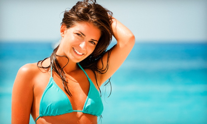 Tahiti Tans & Travel - Bryant: One or Two Custom Spray Tans, or One Month of UV Tanning at Tahiti Tans & Travel (Up to 61% Off)