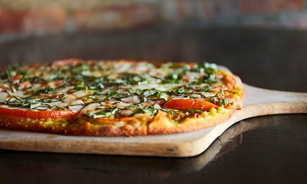 Wood-Fired Pizza and Iron-Skillet Pasta from Red Tomato Pizza (Up to 54% Off). Six Options Available.