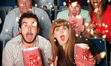 1, 5, or 10 Groupons, Each Good for One Ticket and One Popcorn at Spotlight Theatres (57% Off)