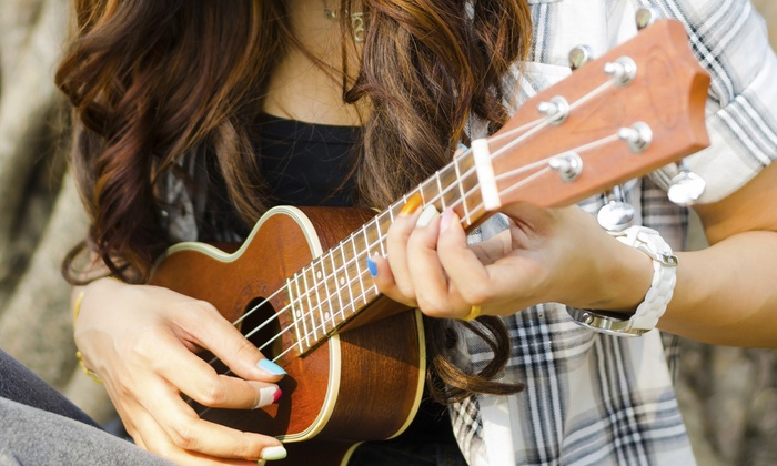 Guitar Grand Rapids - Guitar Grand Rapids,: $29 for One 60-Minute Ukulele Holiday Song Lesson at Guitar Grand Rapids (Up to $45 Value)